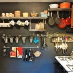 storage space in the kitchen with shelves and hooks